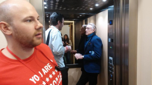 Joel Schumacher in a lift getting babbled at