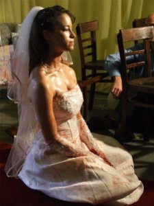 Bride Nicole Meadows, bloodied but unbowed